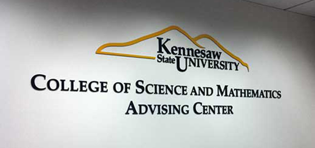 Photo of the Advising Center logo located in the wall in the College of Science and Mathematics Advising Center