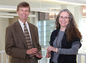 Photo of (left to right) Dr. Mark Anderson, Dean of the College of Science and Mathematics and Dr. Paula Jackson with the 2014-2015 Distinguished Professor Award.