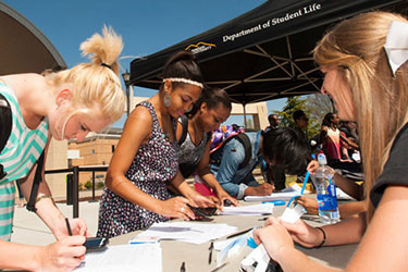 Photo of students signing up to be involved with student groups