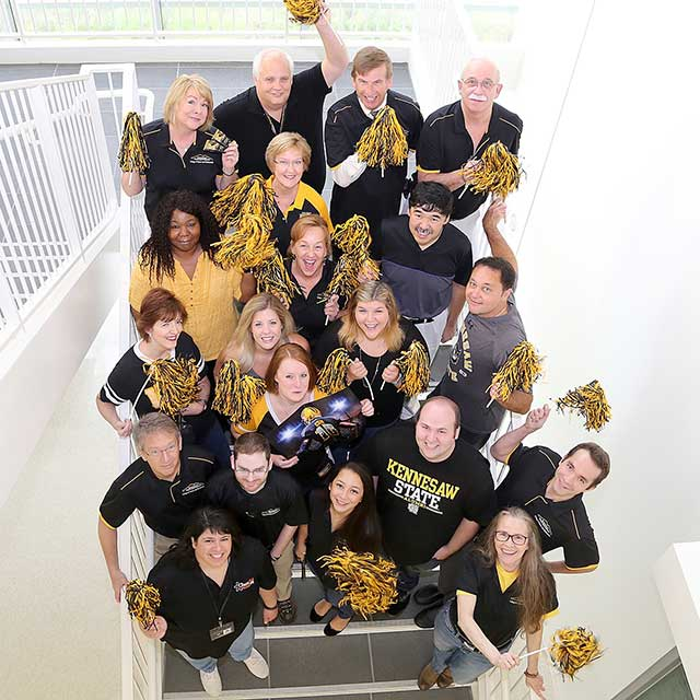 Photo of CSM faculty and Staff KSU Spirit; Link to Discover the Science of Football