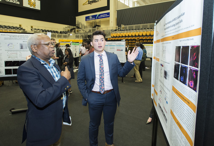 Photo of Biology student giving research presentation at the 2018 Symposium of Student Scholars