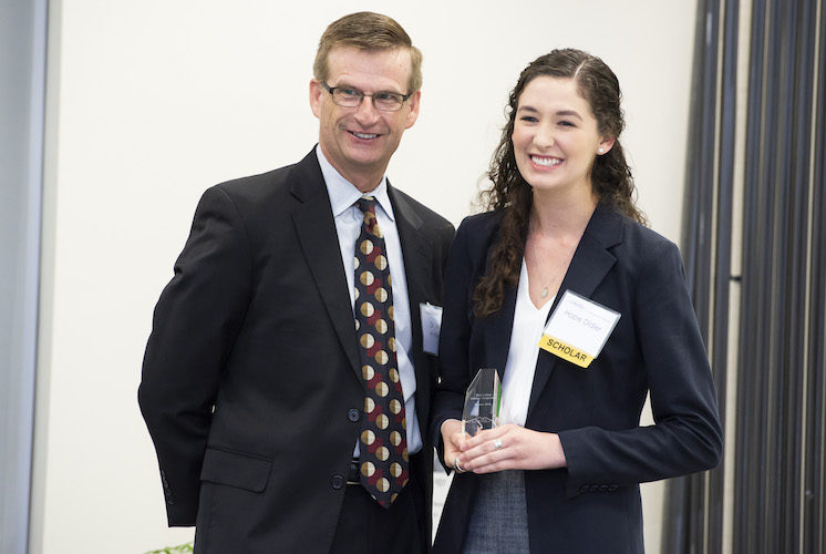 Photo of top poster award reciepient, Hope Didier (right) and Dr. Mark Anderson (left), Dean of the College of Science and Mathematics