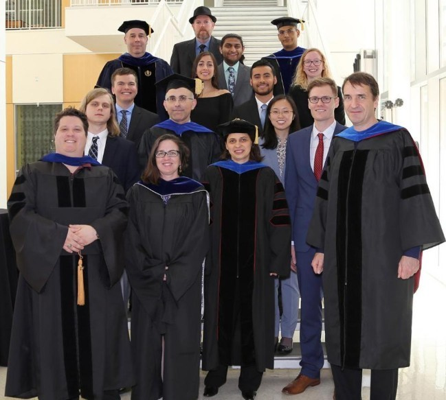 Photo of the College of Science and Mathematics outstanding graduating student award recipients and their faculty mentors