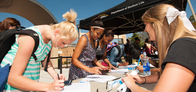 Photo of students registering for student organizations
