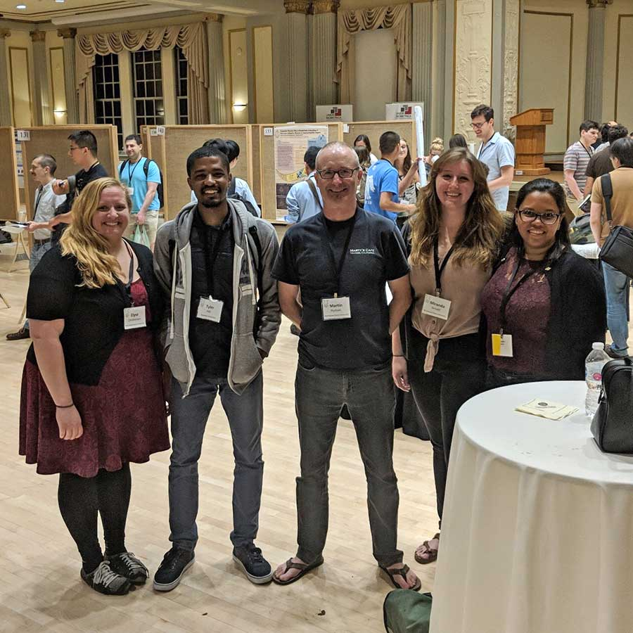 Group photo of Martin Hudson and research laboratory students; From left to right; Elyse Christensen, Tyler Hill, Martin Hudson, Miranda Arnold, and Wendy Aquino-Nunez