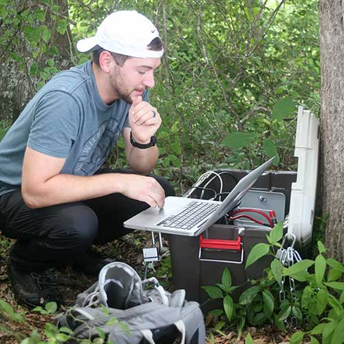 Photo of Master of Science in Integrative Biology graduate student, Will Commins, at Raccoon Creek