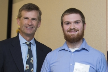 Photo of Mark Anderson, Dean of the College of Science and Mathematics (left) and KSU Junior, Eric Gabilondo, 2015 Birla Carbon Scholar Top Poster Award recipient (right).